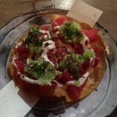 Tuna Sashimi Pizza with Truffle Ponzu, Red Onions and Green Chillies