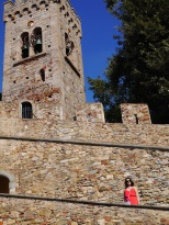 A church in the town of Castagnetto Carducci. And the lady in red would be me :)